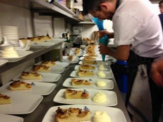 our chef preparing the peach & frangipane tarts.